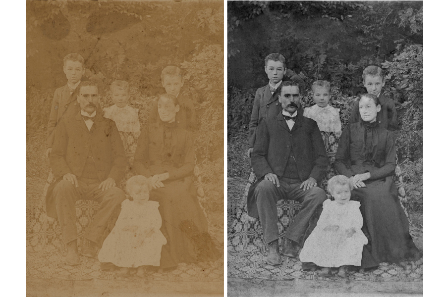 This an example of a photograph restored by Brian Charles Steel Photography.  This image was faded, and had stains and tears. The restored photo depicts a family sitting outside. The young daughter is in front.  The father is on the left and the mother is on the right.  The two sons and other daughter are in the back row.  They are all wearing church clothes.  The background is filled with trees.