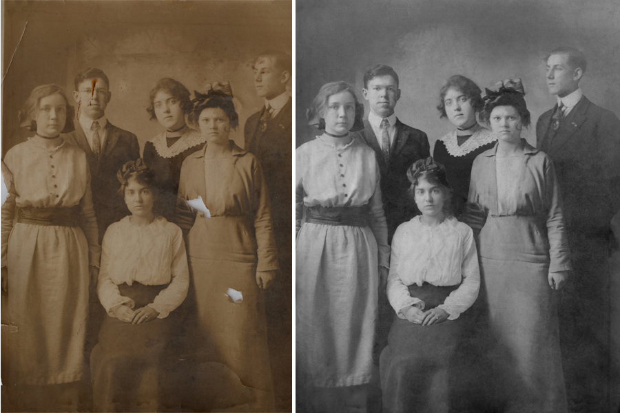 This an example of a photograph restored by Brian Charles Steel Photography.  It is an old group portrait of six people.  There are four women and two men.  In the front, is one woman wearing a white blouse and dark skirt.  She has her hair up, and her hands are folded neatly in her lap.  Standing behind her on the left side, is a woman in a light colored dress.  Her hands are down by her sides.  The top front of her dress has buttons.  Behind her to the right is a man in a suit and tie.  Next to him on his right, is a woman in a dark dress with a white collar.  To her right is a man in a suit and tie.  In front of him, is a woman in a dress with a hat.