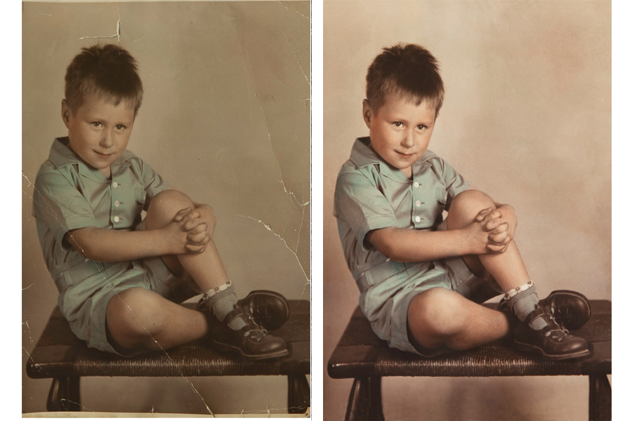 This an example of a photograph restored by Brian Charles Steel Photography.  The photo depicts a young boy sitting on a bench.  There is a light background behind him.  He is wearing a green button up shirt with matching green shorts and socks.   His knees are bent, and his arms are wrapped around his left knee.